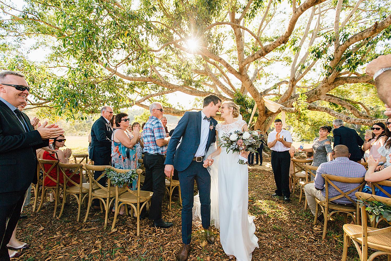 sunshine coast wedding photography ceremony under a tree